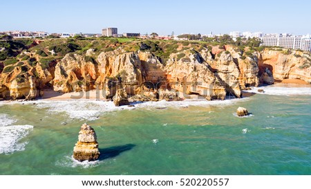Aerial from rocks and ocean near Lagos in Portugal