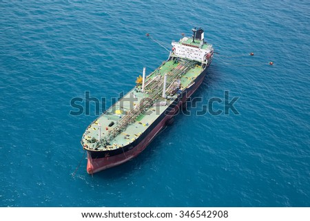 Aerial front side view of oil tanker - stock photo