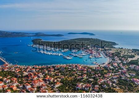 Aerial helicopter photo of marina with boats and sailboats, Adriatic tourist destination Rogoznica, Croatia - stock photo