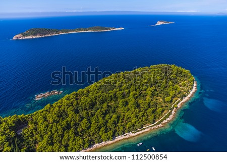 Aerial helicopter shoot of Adriatc landscape with two islands - Dubrovnik archipelago, Croatia. - stock photo