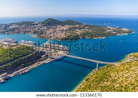 Aerial helicopter shoot of Dubrovnik bridge - entrance to the city and main harbor.