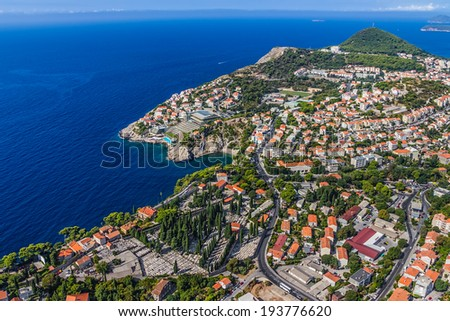 Aerial helicopter shoot of Dubrovnik new town. Residential area, hotels and cemetery. - stock photo