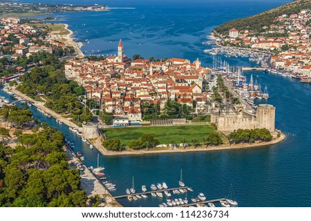 Aerial helicopter shoot of Trogir old town panorama with Kamerlengo Castle in front. Croatian tourist destination. - stock photo