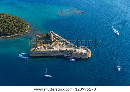 Aerial helicopter shot of St. Nicholas Fortress - Sibenik archipelago, Croatia. - stock photo