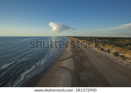 Aerial image of coast line with sandy beach at sunset, Denmark