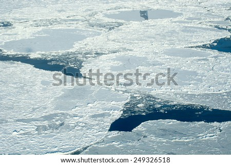 Aerial image of frozen Hudson Bay in Manitoba Canada in November - stock photo