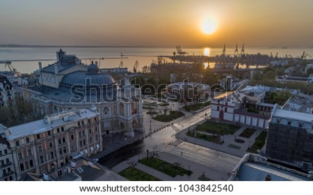Aerial image of sunrise over the Odessa Opera House Ukraine. The port of Odessa is in the background