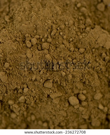 Aerial macro closeup of tasty brown cocoa chocolate powder - stock photo