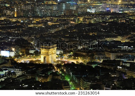 Aerial Night view of Arc de Triomphe and Paris City shot on the top of Eiffel Tower - stock photo