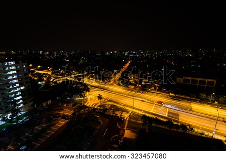 Aerial night view of new estate, HDB housing complex near the highway in Eunos area, Singapore - stock photo