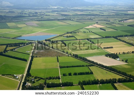 Aerial of complex intersection amid cropping farms in Canterbury, South Island, New Zealand - stock photo