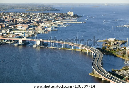 Aerial of downtown Portland, Maine showing Maine Medical Center, Commercial street, Old Port, Back Bay and the Casco Bay Bridge from South Portland - stock photo