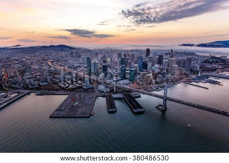 Aerial of foggy San Francisco at sunset - stock photo