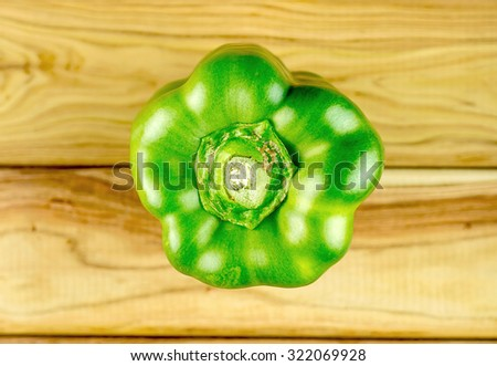 Aerial of green capsicum on cutting board - stock photo
