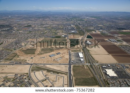 Aerial of growth and development along Interstate near Goodyear looking east towards Phoenix, Arizona