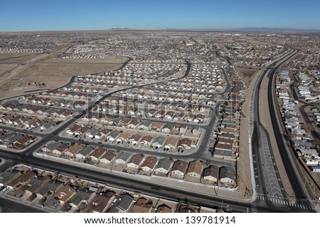 Aerial of modern residential neighborhoods in arid Albuquerque, New Mexico, USA. - stock photo