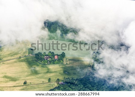 aerial of rural landscape in Hamburg by approaching Hamburg airport - stock photo