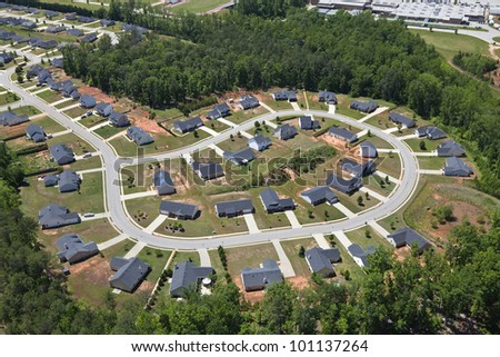 Aerial of suburban neighborhood culdesac homes in the eastern United States. - stock photo