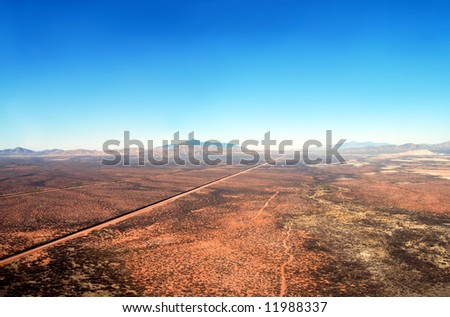 Aerial Of The U S Mexico Border Fence In The Arizona Desert