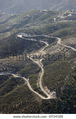 Aerial of winding scenic road in California, USA. - stock photo