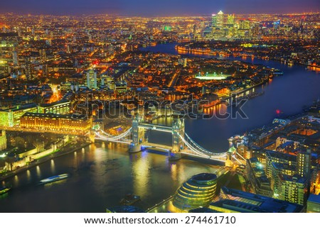 Aerial overview of London city with the Tower bridge at the night time - stock photo