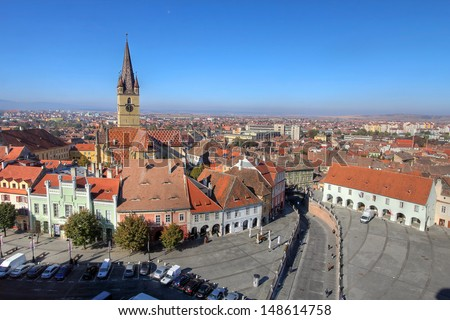 Aerial overview of Sibiu, Romania from the Council Tower with the Small Square (Piata Mica) and the ramp heading to the Lower town, while the Evanghelical Lutheran Cathedral dominates the skyline. - stock photo