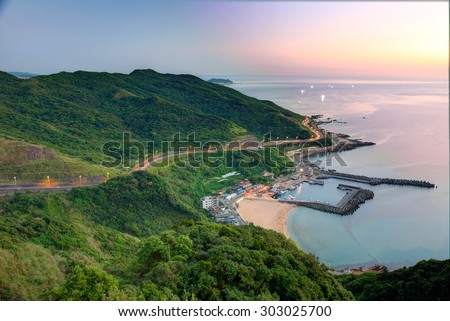 Aerial panorama of a fishing village at dawn on northern coast of Taipei Taiwan ~ Beautiful scenery of coast highway, coast line and a fishing village at dawn ~ - stock photo