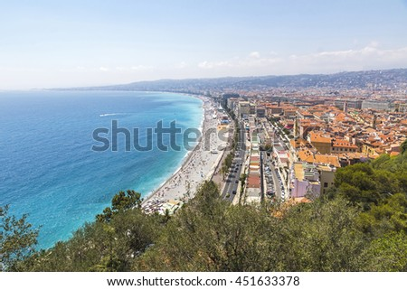 Aerial panorama of beautiful beach in City of Nice in sunny summer day, Cote d'Azure, France. City of Nice is a famous and luxury resort of French riviera - stock photo