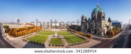 Aerial panorama of Central Berlin with Museum Island and Berlin Cathedral on a misty Autumn morning - stock photo