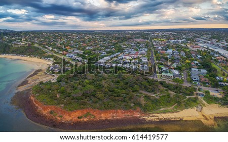 Aerial panorama of coastline, beaches and Australian suburban area at sunset. Mornington Peninsula, Melbourne, Victoria, Australia