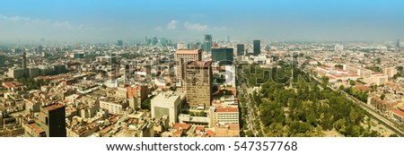 Aerial panorama of Mexico City on a sunny morning with Central Alameda Park on the right. Mexico City is a capitol of Mexico. The camera is pointed to the west.