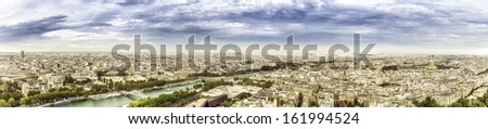 Aerial panorama of Paris with scenic sky, France - stock photo