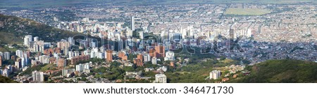 Aerial panorama of the city of Cali taken from the top of Cristo del Rey against a blue sky. Colombia 2015 - stock photo
