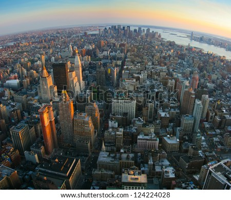 Aerial panoramic fish-eye view over lower Manhattan, New York from Empire State building top at sunset - stock photo