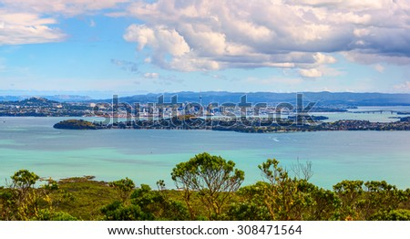 Aerial panoramic view of Auckland City downtown from Rangitoto Island mountain. New Zealand. - stock photo