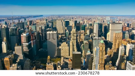 Aerial panoramic view over upper Manhattan, New York. Sunset of a clean, sunny day with exceptional visibility. - stock photo