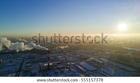Aerial panoramic view: Sunny winter cold morning above city,  the steam clouds and pipes thermal power plants in major city, Saint Petersburg, Russia