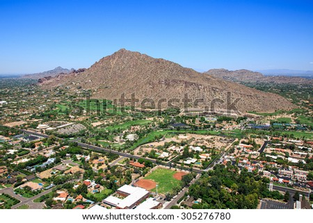 Aerial perspective of exclusive homes and golf course near Camelback Mountain in Phoenix, Arizona - stock photo