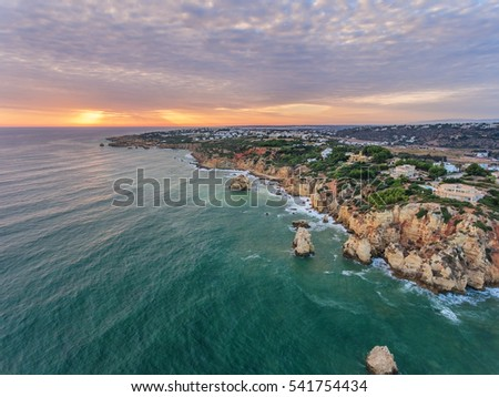 Aerial. Photo from the air, the beaches of Albufeira. Sunset. Albufeira