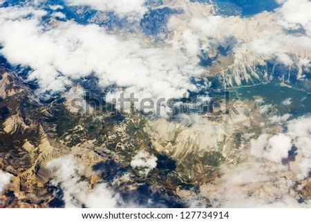 Aerial photo of mountains in sunlight with clouds
