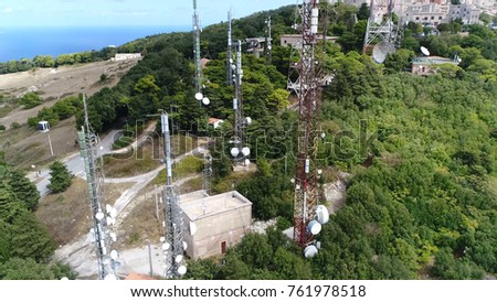Aerial photo of radio masts and towers structures designed to support antennas also known as aerials for telecommunications and radio and television broadcasting and for example cell phones