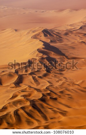 Aerial photo of red sand dunes in the Namib desert, Namibia - stock photo