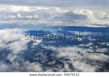 Aerial photo of the coast of New Guinea with jungles - stock photo