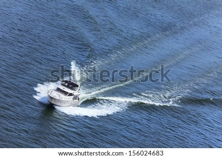 Aerial photograph of luxury power boat yacht speedboat on blue sea