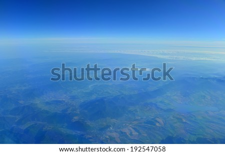 Aerial photograph of terrain and sky - stock photo