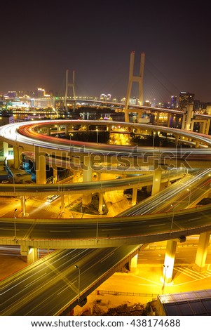 Aerial photography at Asia's largest across the rivers in Shanghai landmarks a spiral nanpu bridge of night scene  - stock photo