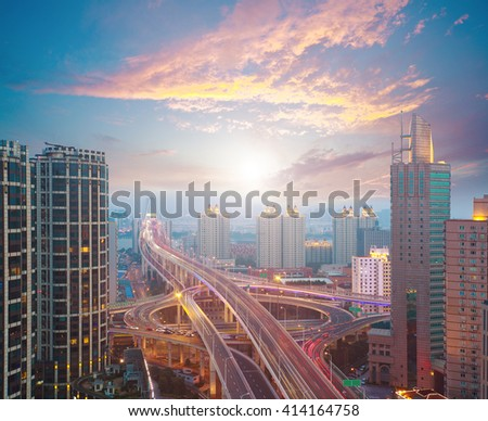 Aerial photography at city elevated bridge of sunrise pink clouds