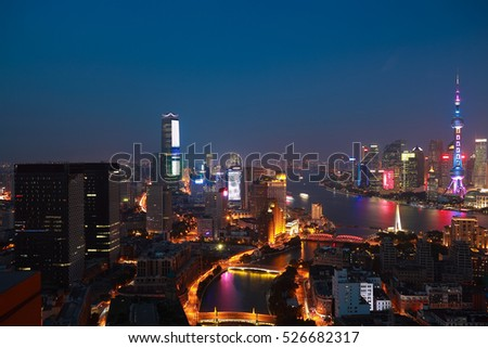 Aerial photography bird view city landmark buildings background at Shanghai bund Skyline of night scene