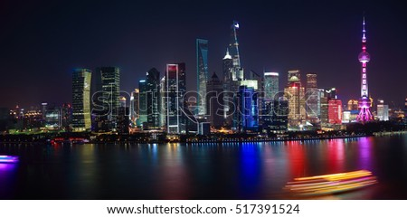 Aerial photography bird view city landmark buildings background at Shanghai Skyline of panorama of night scene