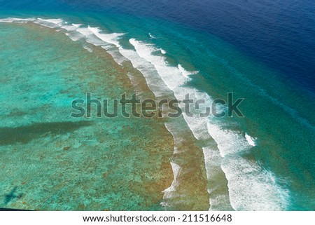 Aerial picture of blue and crystal sea water in Maldives region - stock photo